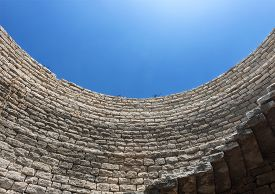 Looking Up To The Blue Sky From Inside A Stone Water Well