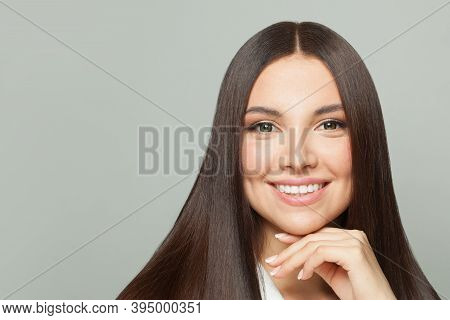 Healthy Model Woman With Clear Skin And Long Healthy Straight Hair Smiling On White Background. Hair