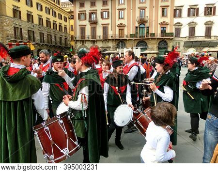 Florence, Italy - May 01, 2014: Tourists Watching Trofeo Marzocco Parade In Florence, Italy. The Tro