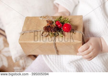 Child's Hands Holding Gift Box. Copy Space. Christmas, Hew Year, Birthday Concept.