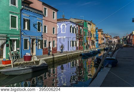 Burano, Italy - 2 FEBRUARY  2016 - Colorful houses and boat by the water canal at the island Burano.