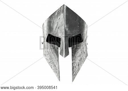 Front View Of Ancient Iron Spartan Helmet Isolated On White Studio Background. Medieval Armor, Arche