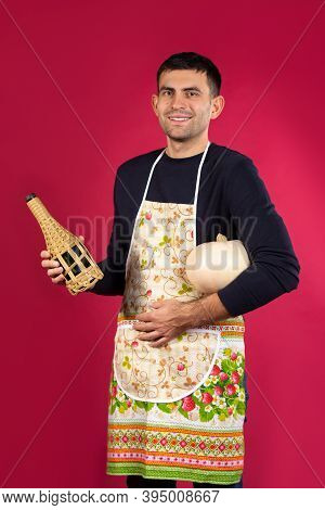 A Man Smiles After Cooking Dinner And Poses With His Chosen Drink. The Concept Of Gender Stereotypes