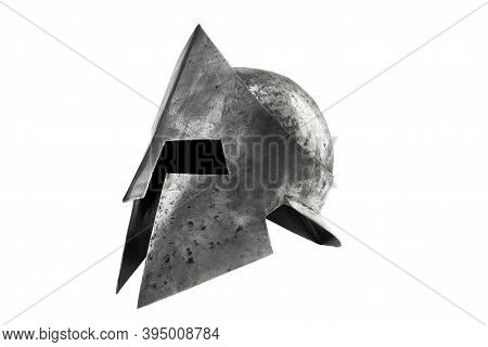 Side View Of Ancient Metal Tough Spartan Helmet Isolated On White Studio Background. Medieval Armor,