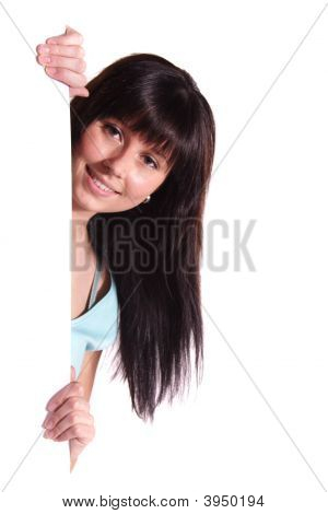 A young handsome woman hides behind an invisible wall. All isolated on white background. poster