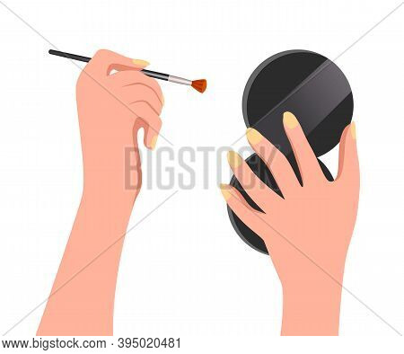 Close-up Image Of Female Hands With A Make-up Round Mirror And A Brush For Eyeshadow Or Makeup. Beau