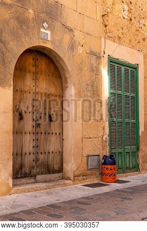 Campos, Balearic Islands/spain; November 2020: An Empty Butane Cylinder At The Door Of A House Waiti