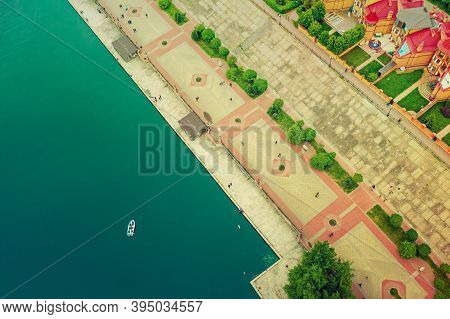 Aerial View On River Dnepr With The Boat In Green Obolon Area Of Kyiv City. Flying Drone Camera Shot