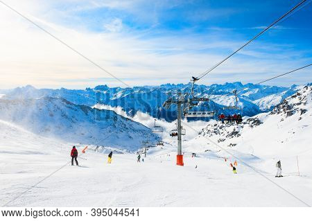 Ski Resort In Winter Alps. Skiers Ride Down The Slope. Val Thorens, 3 Valleys, France. Beautiful Mou