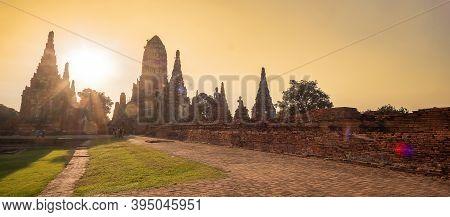 Beautiful Sunset Ancient Stupa In Wat Chaiwatthanaram Temple In Ayutthaya Historical Park, A Unesco