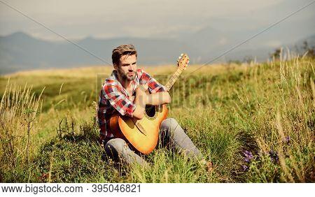 Wanderlust Concept. Inspiring Nature. Summer Vacation Highlands Nature. Musician Looking For Inspira