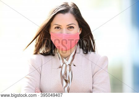 Front View Portrait Of A Happy Woman Wearing Protective Mask Avoiding Coronavirus Contagion Or Pollu