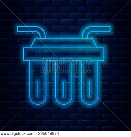 Glowing Neon Line Water Filter Icon Isolated On Brick Wall Background. System For Filtration Of Wate
