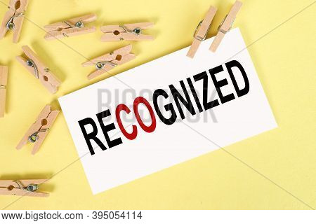 Recognized, Text On White Paper On A Yellow Background