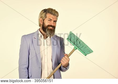 Where Start Cleaning. Clear Reputation. Hipster Hold Cleaning Tool. Man Use Broom. Businessman Sweep