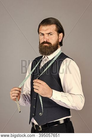 Handsome Tailor In White Shirt Working. Amazing Atelier With Antique Furniture. Portrait Of Tailor-m