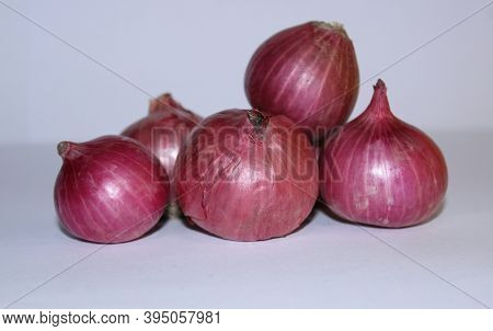 Bulb Onion Or Common Onion, Some Red Onion (allium Cepa) With White Background.