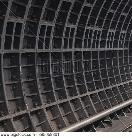Dark Dusty Surface Of Deep-running Underground Tunnel With Bolted Joints Of Prefabricated Reinforced