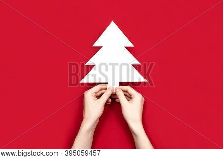 Christmas Fir Tree Silhouette Cut Out Of White Paper Flat Lay, Copy Space. Creative Christmas Compos