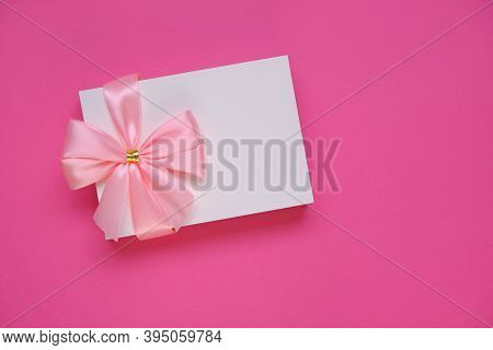 Postcard Blank. Holiday Greeting Card With Pink Bow On Bright Pink Background.birthday Blank Postcar