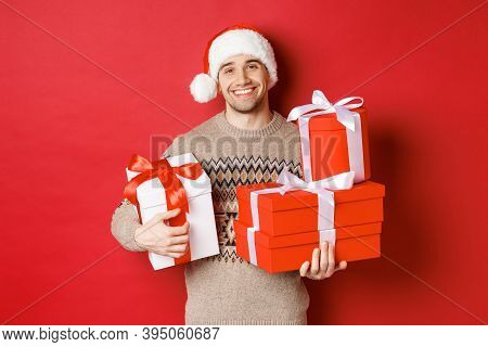 Concept Of Winter Holidays, New Year And Celebration. Portrait Of Lovely Smiling Man Prepared Gifts
