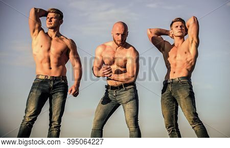 More Strength More Muscle. Strong Men Blue Sky Background. Showing Abs Biceps. Group Muscular Men Ou