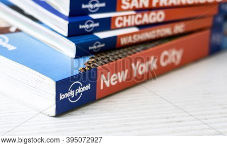 Rome, Italy, November 15th 2020: The Lonely Planet Logo On The Back Of A Series Of Stacked Travel Gu