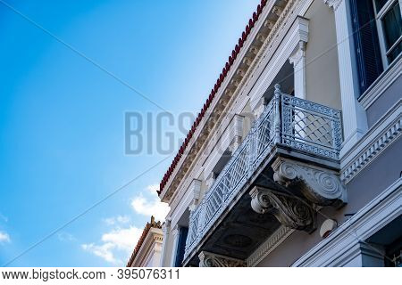 Neoclassical Building Facade With Balcony Detail, Blue Sky Background, Plaka, Athens Greece. Low Ang
