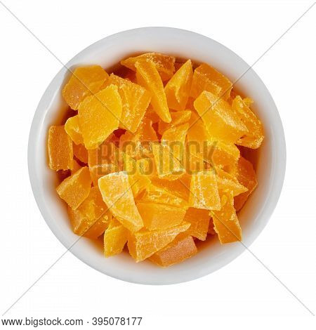 Sun-dried Fruit Mango Candies Or Candied Fruits In A Ceramic Cup, Isolate On White, Top View.