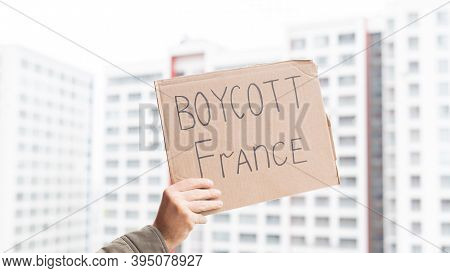 2 November 2020 France Paris: A Man Holds A Cardboard Poster With The Inscription Boycott Of France