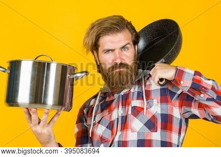 Cooking Utensils. Kitchenware. Cooking Tools. Kitchen Advertising. Bearded Man With Frypan. Man Chef