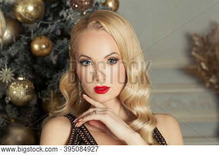 Christmas Woman With Blonde Hair And Makeup At Home. Christmas Holiday And New Year Party Concept