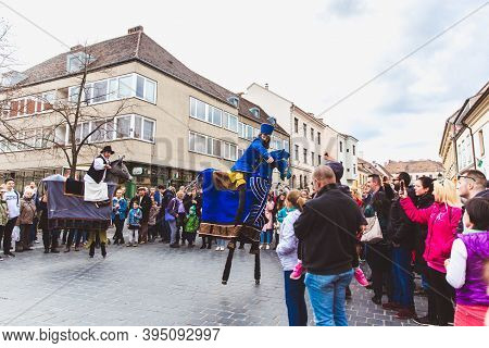 Budapest - March 15: Performance Of Artists On Stilts On A Street In The Buda Castle On The Day Of T
