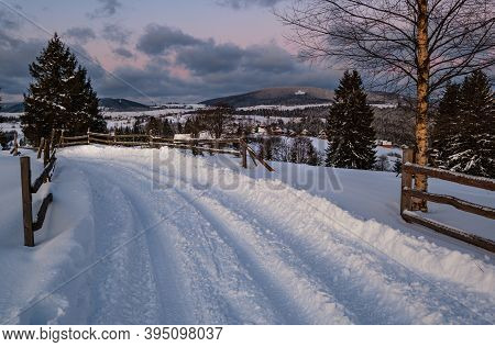 Snow Drifts On Road Through Twilight Small And Quiet Winter Alpine Village, Voronenko, Carpathian, U
