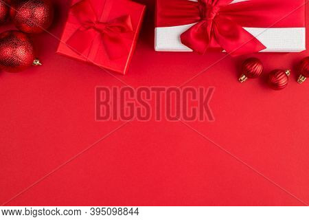 Winter Holidays Coming Soon Concept. Top Above Overhead View Photo Of Red Baubles White And Red Gift