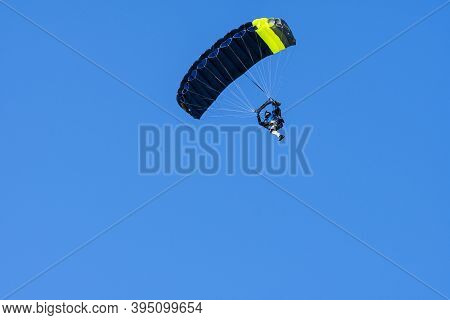 Tandem Parachute Jump. Silhouette Of Skydiver Flying In Blue Clear Sky. Concepts Of Extreme Sport An