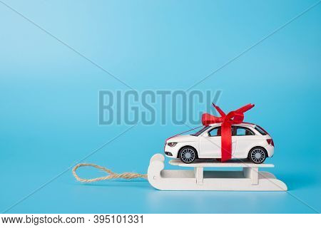 Winter Sale Concept. Present Concept. Close Up Full Length Size Photo Of Toy White Car In With Red R