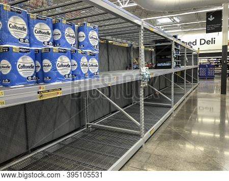 Indianapolis - Circa November 2020: Empty Toilet Paper Shelves At A Retailer. A Second And Third Wav