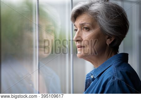 Close Up Thoughtful Upset Mature Woman Looking Out Window