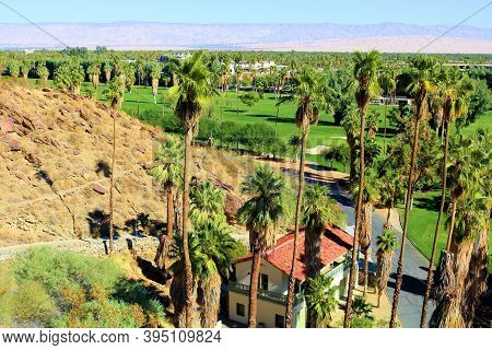 November 15, 2020 In Palm Springs, Ca:  Lush Manicured Grass And Palm Trees With Spanish Colonial St