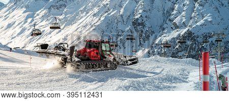 Red Modern Snowcat Ratrack With Snowplow Snow Grooming Machine Preparing Ski Slope Piste Hillalpine