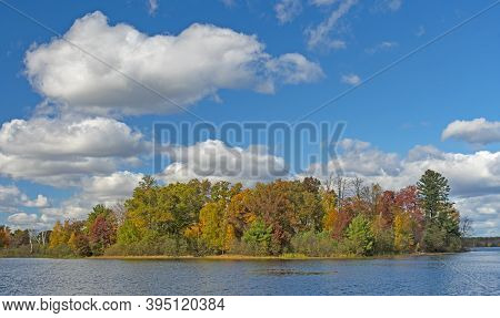 Puffy Clouds On A Sunny Autumn Day In Governor Thompson State Park In Wisconsin