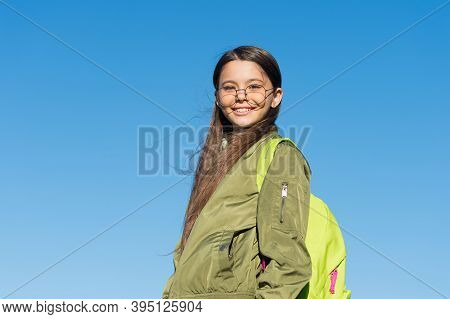 A New Sky, A New Life. Happy Girl Carry Backpack Outdoors. Traveling And Wanderlust. Autumn Vacation