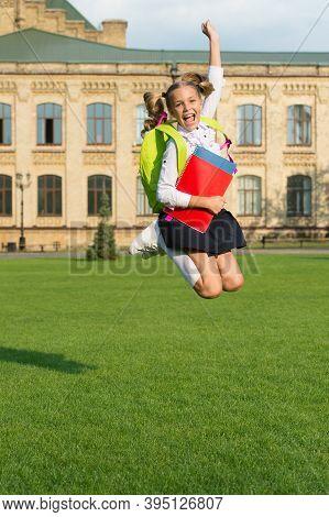 Spare Time. Energetic Kid Jump In Schoolyard. School Holidays. Happy Pupil In Midair. Graduation Day