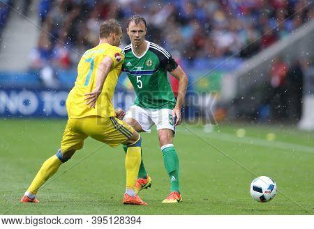 Lyon, France - June 16, 2016: Andriy Yarmolenko Of Ukraine (l) Fights For A Ball With Jonny Evans Of