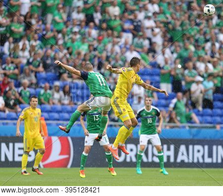 Lyon, France - June 16, 2016: Conor Washington Of Northern Ireland (l) Fights For A Ball With Yevhen