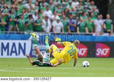 Lyon, France - June 16, 2016: Jamie Ward Of Northern Ireland (l) Fights For A Ball With Yaroslav Rak