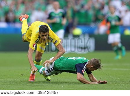 Lyon, France - June 16, 2016: Yevhen Khacheridi Of Ukraine (l) Fights For A Ball With Jamie Ward Of