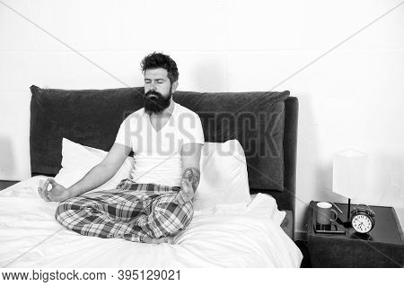 I Love Meditation. Brutal Hipster Do Meditation In Bed. Bearded Man Enjoy Meditation Practice. Medit