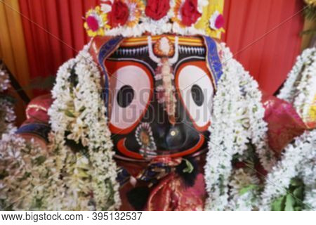 Blurred Image Of Idol Of Hindu God Jagannath. Lord Jagannath Is Being Worshipped With Garlands For R